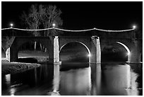 Pont Vieux illuminated by night with Christmas lights. Carcassonne, France (black and white)