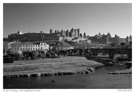 Aude River, Pont Vieux and medieval city. Carcassonne, France (black and white)