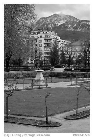 Public garden and snowy mountains. Grenoble, France (black and white)
