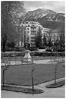 Public garden and snowy mountains. Grenoble, France ( black and white)