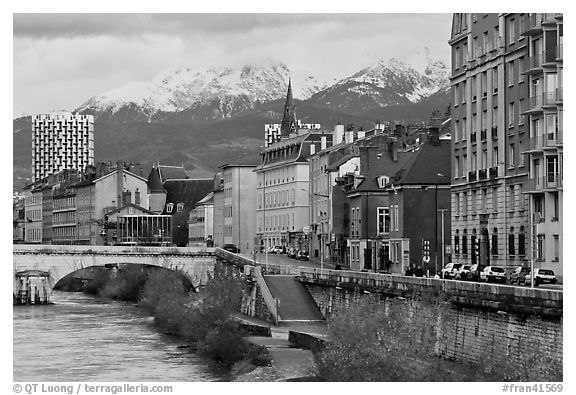 Isere riverbank and snowy mountains. Grenoble, France (black and white)