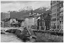 Isere riverbank and snowy mountains. Grenoble, France ( black and white)