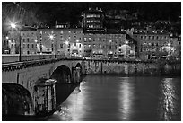 Isere River, Citadelle stone bridge and old houses at dusk. Grenoble, France (black and white)