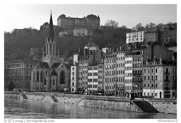 Saint George church and houses on the banks of the Saone River. Lyon, France (black and white)