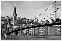 Suspension brige on the Saone River and St-George church. Lyon, France (black and white)