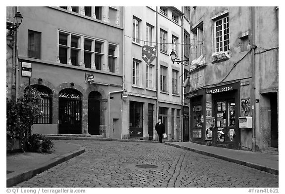 Small square in old city with coblestone pavement. Lyon, France (black and white)