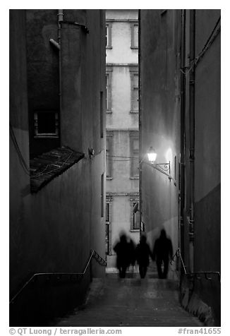 Silhouettes in staircase on Fourviere Hill at dusk. Lyon, France (black and white)