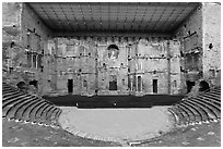 Tiered seats, orchestra, stage, and stage roof, Roman theater. Provence, France (black and white)