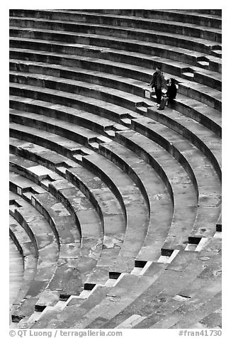 Couple standing in amphitheater, Orange. Provence, France (black and white)