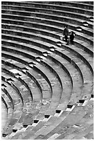 Couple standing in amphitheater, Orange. Provence, France ( black and white)