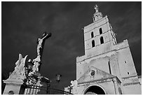 Crucifix and romanesque tower of Notre-Dame-des-Doms Cathedral. Avignon, Provence, France (black and white)