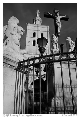 Cross in front of Notre-Dame-des-Doms Cathedral. Avignon, Provence, France (black and white)