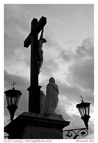 Cross with Christ at sunset. Avignon, Provence, France (black and white)
