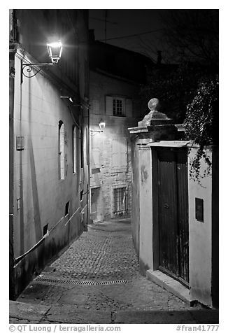 black and white picture photo narrow cobblestone street and street light avignon provence france. Black Bedroom Furniture Sets. Home Design Ideas