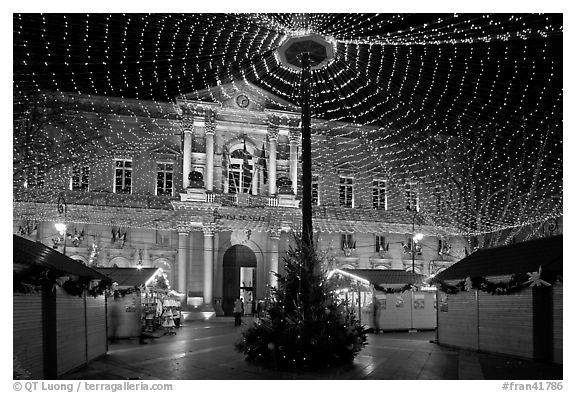 Christmas fair and City hall at night. Avignon, Provence, France (black and white)