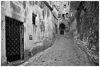 Narrow street, Les Baux-de-Provence. Provence, France (black and white)