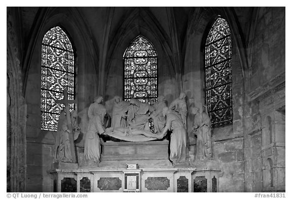 Christ sculpture and stained glass windows, St Trophime church. Arles, Provence, France (black and white)