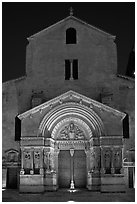Facade of the Saint Trophimus church at night. Arles, Provence, France (black and white)