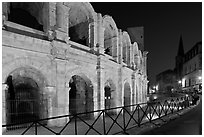 Arenes and church at night. Arles, Provence, France (black and white)