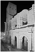 Arenes Roman amphitheater with defensive tower at night. Arles, Provence, France ( black and white)