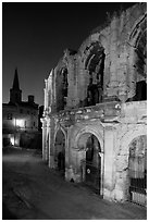Roman arenes and church at night. Arles, Provence, France (black and white)