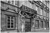 Facade with sculptures supporting a balcony. Aix-en-Provence, France ( black and white)