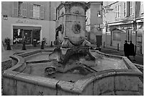 Fountain in old town plaza. Aix-en-Provence, France ( black and white)