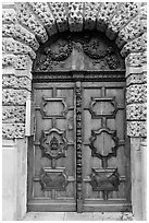 Decorated wooden door. Aix-en-Provence, France ( black and white)