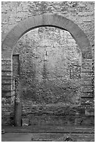 Arch opening in Thermes de Constantin. Arles, Provence, France (black and white)