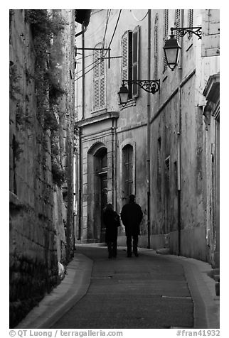 Couple walking in old street. Arles, Provence, France (black and white)