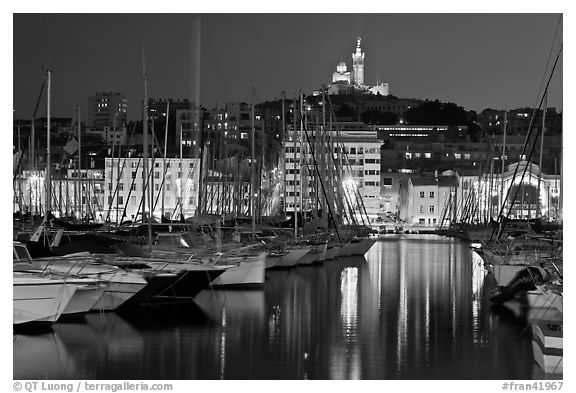 Harbor and Notre Dame de la Garde Basilic on hill. Marseille, France (black and white)