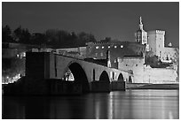St Benezet Bridge and Palace of the Popes at night. Avignon, Provence, France (black and white)