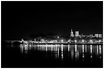 Avignon skyline at night with lights reflected in Rhone River. Avignon, Provence, France ( black and white)
