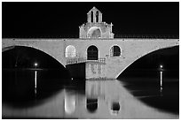 St Benezet Bridge with chapel of St Benezet at night. Avignon, Provence, France (black and white)