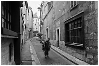 Boy walking in narrow street, Chartres. France (black and white)