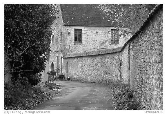 Street and stone wall, Provins. France (black and white)