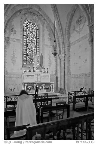 Monks praying in chapel, Saint Quiriace Collegiate Church, Provins. France (black and white)