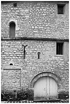 Facade detail of medieval house with small windows, Provins. France ( black and white)