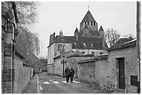 Street with couple walking and Caesar's Tower in background, Provins. France (black and white)