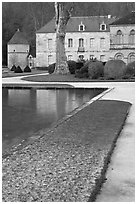 Pond and Abbot's lodging, Fontenay Abbey. Burgundy, France (black and white)