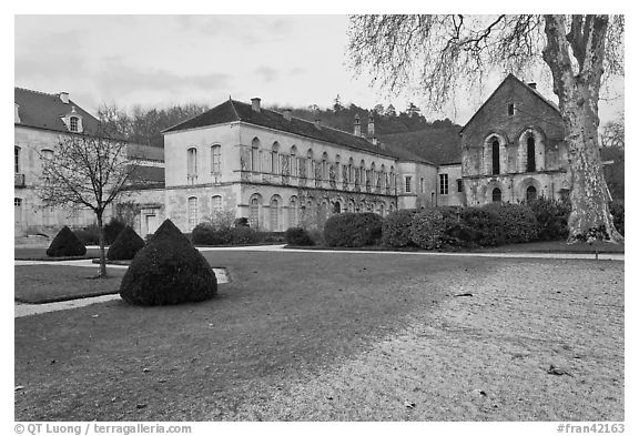 Lawn and forge in winter, Abbaye de Fontenay. Burgundy, France (black and white)