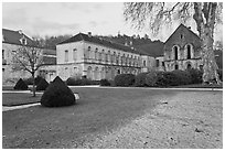 Lawn and forge in winter, Abbaye de Fontenay. Burgundy, France ( black and white)