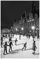 Holiday ice ring, City Hall by night. Paris, France (black and white)