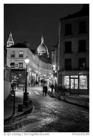 Street and Sacre-Coeur dome at night, Montmartre. Paris, France (black and white)