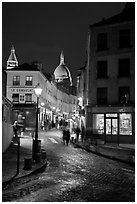 Street and Sacre-Coeur dome at night, Montmartre. Paris, France ( black and white)