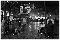 Place du Tertre by night with Christmas lights, Montmartre. Paris, France (black and white)