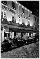 Restaurant with outdoor sitting by night, Montmartre. Paris, France ( black and white)