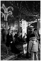 Portraitist at work, Place du Tertre, Montmartre. Paris, France ( black and white)