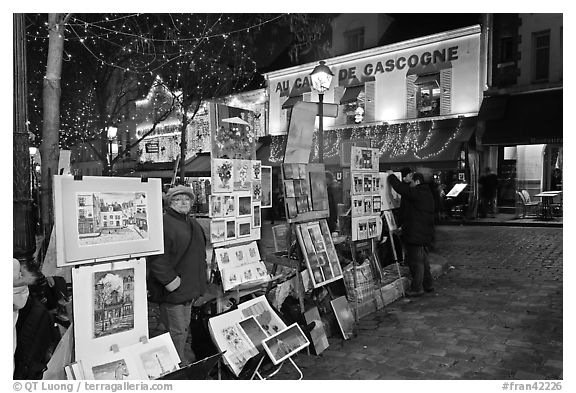 Art for sale on Place du Tertre at night, Montmartre. Paris, France (black and white)