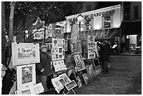 Art for sale on Place du Tertre at night, Montmartre. Paris, France ( black and white)